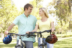 Portrait Of Young Couple On Bike Ride Stock Image