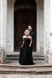 Portrait of a young couple in black suit and dress. Wedding Stock Images