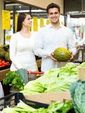 Portrait of young couple buying vegetables Stock Photography