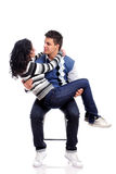 Portrait of a young couple on a chair Royalty Free Stock Images