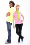 Portrait of young couple - copy space. Young couple - black man,white women standing on the white background Stock Photos