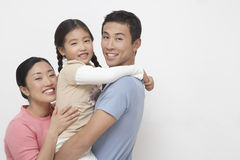 Portrait Of Young Couple With Daughter Royalty Free Stock Photos