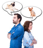 Portrait of young couple dreaming about different dogs isolated. On white background Royalty Free Stock Photography