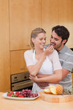 Portrait of a young couple eating fruits Stock Image