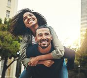 Portrait of a young couple enjoying in the city royalty free stock photography