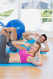 Portrait of a young couple exercising at gym Royalty Free Stock Photography