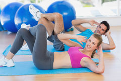 Portrait of a young couple exercising at gym Royalty Free Stock Photo