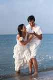 Portrait of young couple fooling on the beach Royalty Free Stock Photography