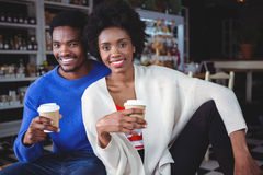 Portrait of young couple having coffee Royalty Free Stock Images