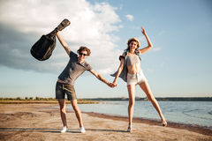 Portrait of a young couple having fun on the beach Stock Photo