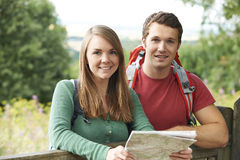 Portrait Of Young Couple Hiking In The Countryside Stock Image