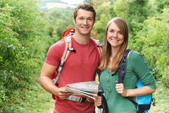 Portrait Of Young Couple Hiking In Countryside Royalty Free Stock Photography