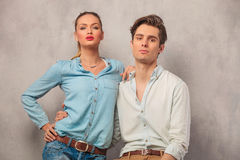 Portrait of young couple holding each other in studio. Portrait of young couple holding each other while posing in studio background Stock Photo
