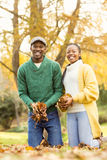 Portrait of a young couple holding leaves Stock Image