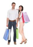 Portrait of young couple holding shopping bag Royalty Free Stock Photos