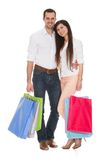 Portrait Of Young Couple Holding Shopping Bag Royalty Free Stock Images