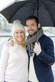 Portrait of a young couple on holidays under the rain Royalty Free Stock Images