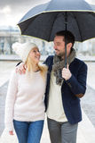 Portrait of a young couple on holidays under the rain Royalty Free Stock Photos