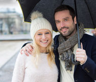 Portrait of a young couple on holidays under the rain Royalty Free Stock Image