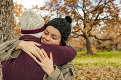 Portrait young couple hugging in an autumn background. Back view Stock Images