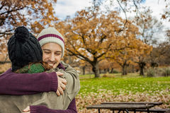 Portrait young couple hugging in an autumn background. Back view Stock Photography