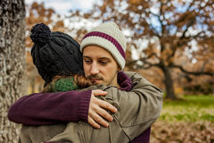 Portrait young couple hugging in an autumn background. Back view Royalty Free Stock Photography