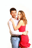 Portrait of young couple hugging isolated on white background Royalty Free Stock Photography