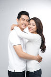 Portrait Of Young Couple Hugging Stock Photos