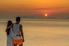Portrait of a young couple hugging at sunset on Santorini island. rear view. Concept-love, freedom, relationship, travel, adventur. E Stock Photos