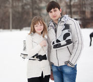 Portrait of young couple on ice skate rink Stock Photo