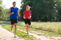 Portrait Of Young Couple Jogging Royalty Free Stock Photos
