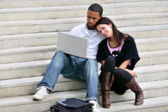 Portrait of a young couple with laptop Stock Photo