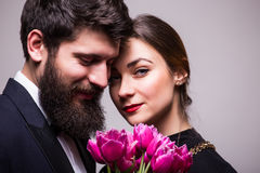 Portrait of young couple with lila tulips stock images