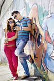 Portrait of a young couple looking at mobile phone stock image