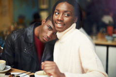 Portrait of young couple in love at a coffee shop, two people in cafe enjoying the time spending with each other, Stock Photos