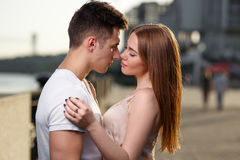 Portrait of young couple in love, enjoying the sunset in city.  Stock Photo