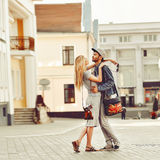 Portrait of young couple in love standing in old town. Outdoors Royalty Free Stock Photography