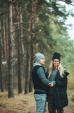 Portrait of young couple in love walking in beautiful forest enjoying hugging and smiling. Feelings, togetherness Stock Images
