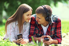 Portrait of young couple lying relaxing on the grass together Stock Photography