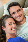Portrait of young couple lying together on sofa Royalty Free Stock Photo