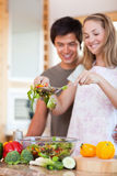 Portrait of a young couple making a salad Stock Photo