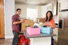 Portrait Of Young Couple Moving In To New Home Together Stock Photo