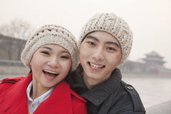 Portrait of young couple outdoors in wintertime, Beijing Royalty Free Stock Image