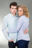 Portrait of young couple over grey Stock Photos