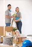 Portrait of young couple painting their home stock photos