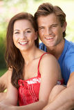 Portrait Of Young Couple Relaxing In Park Stock Image