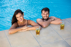 Portrait of young couple relaxing in the pool Royalty Free Stock Photo