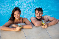 Portrait of young couple relaxing in the pool Royalty Free Stock Photography