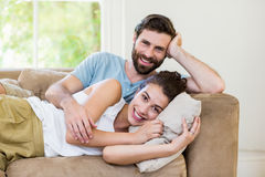Portrait of young couple relaxing on sofa Stock Images