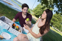 Portrait young couple during romantic picnic in countryside Stock Images